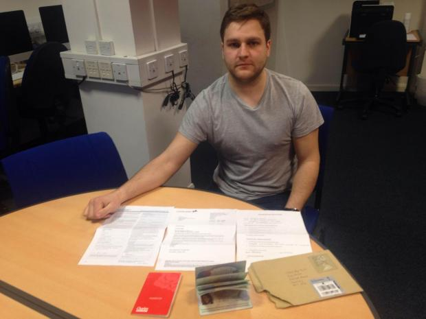 Student Mathew Di Salvo with the personal documents in Newcastle