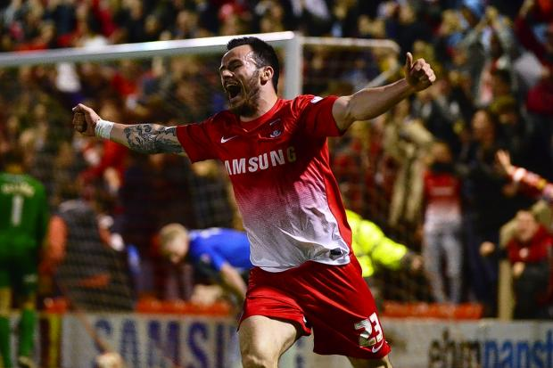 Chris Dagnall celebrates the goal which helped take Orient to Wembley: Simon O'Connor
