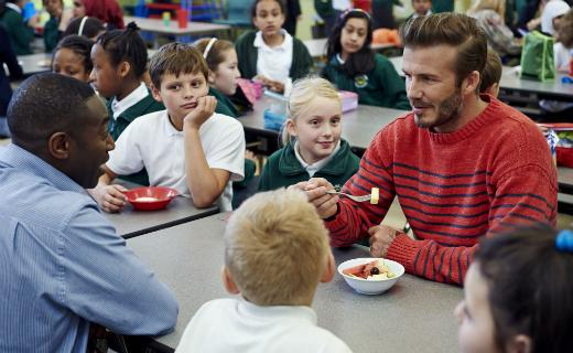 East London and West Essex Guardian Series: Beckham sat with pupils during their lunch break and spoke about the improvement in school dinners (credit: Sainsburys)