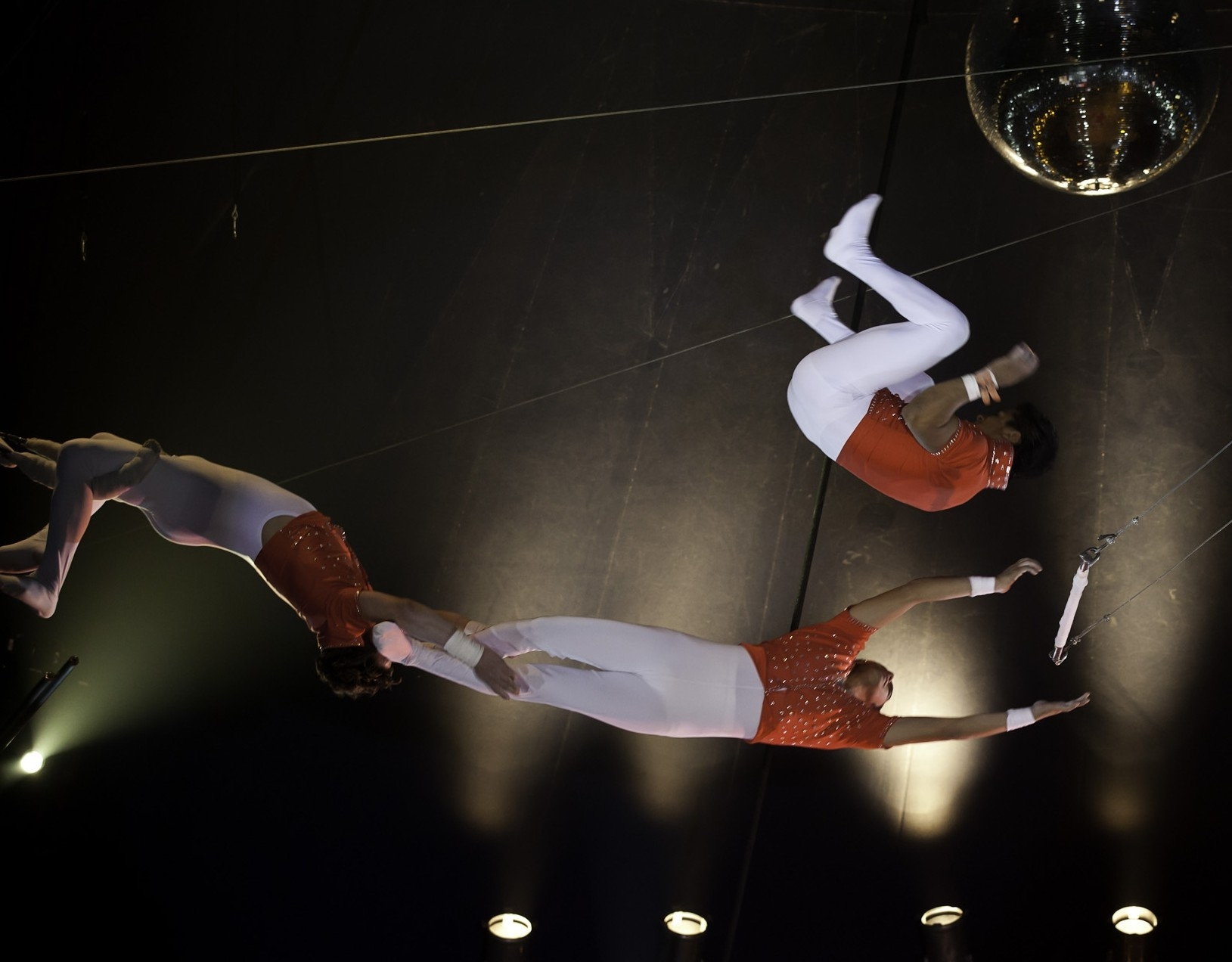 Santus Circus performers on a trapeze.
