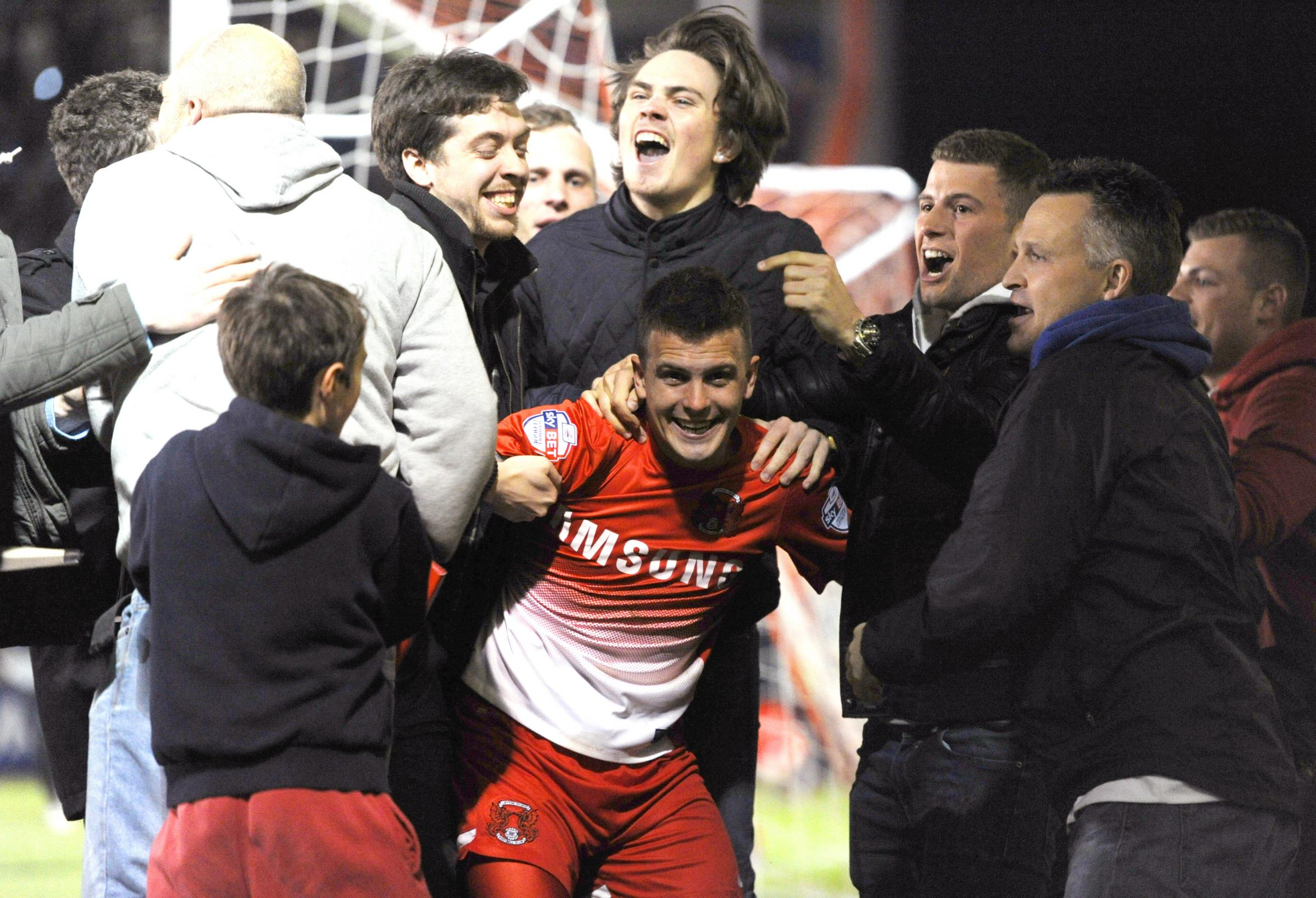 Dean Cox celebrates Orient's first goal on Tuesday night with O's fans