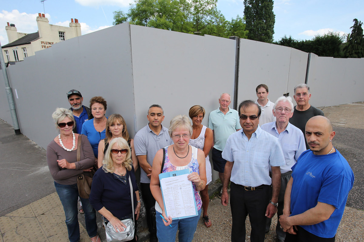 Local residents and buisnesses are unhappy about plans proposed for a Sainsbury's local and six flats on the old Church Hill Car Park in Loughton.