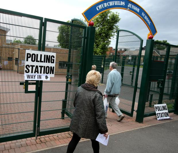 Voters going into the polling station at Churchfields Junior School South Woodford this lunchtime