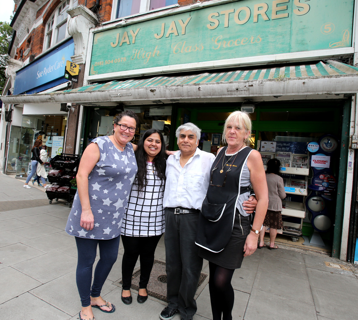 Staff Sally Powells, Gauri Bagne, Rajan Madlani and Natalie Savage outside Jay Jay Stores