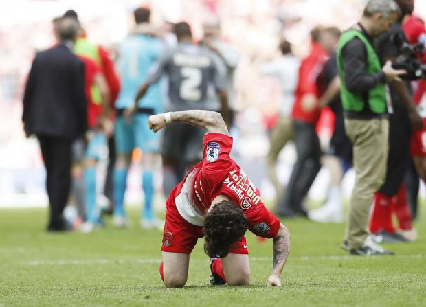 Romain Vincelot punches the turf after Orient's penalty shoot-out defeat at Wembley. Picture: Action Images