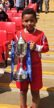 Harvey Livings-Corbin with the trophy at Wembley