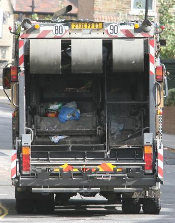 The driver of a rubbish truck was attacked by three people (file picture)