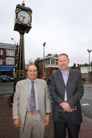 Labour councillor's Aktar Beg and Tony Bell outside the clock in Highams Park