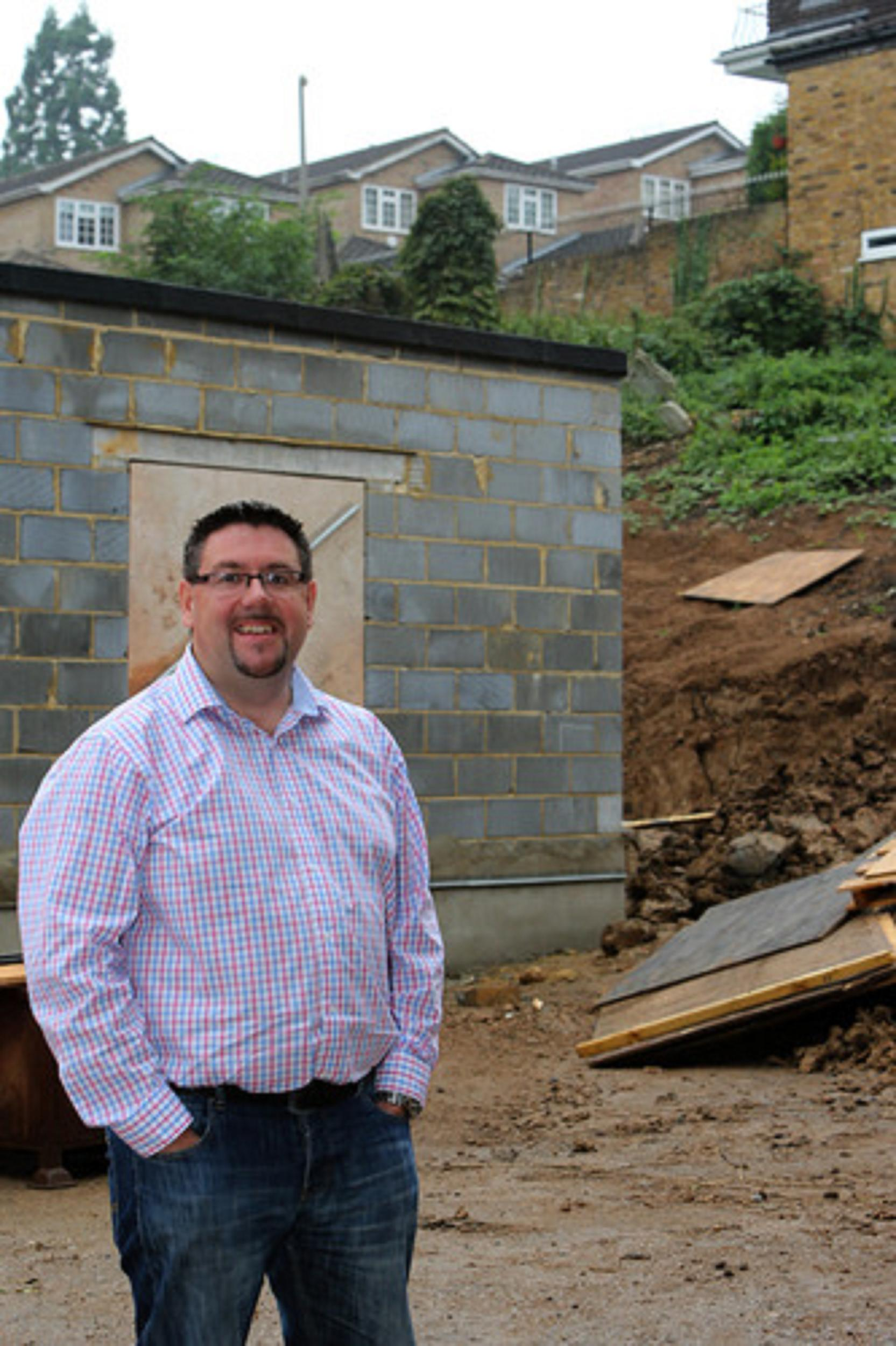 Reverend Wayne Dulson on the site of building works for the church nursery in 2013