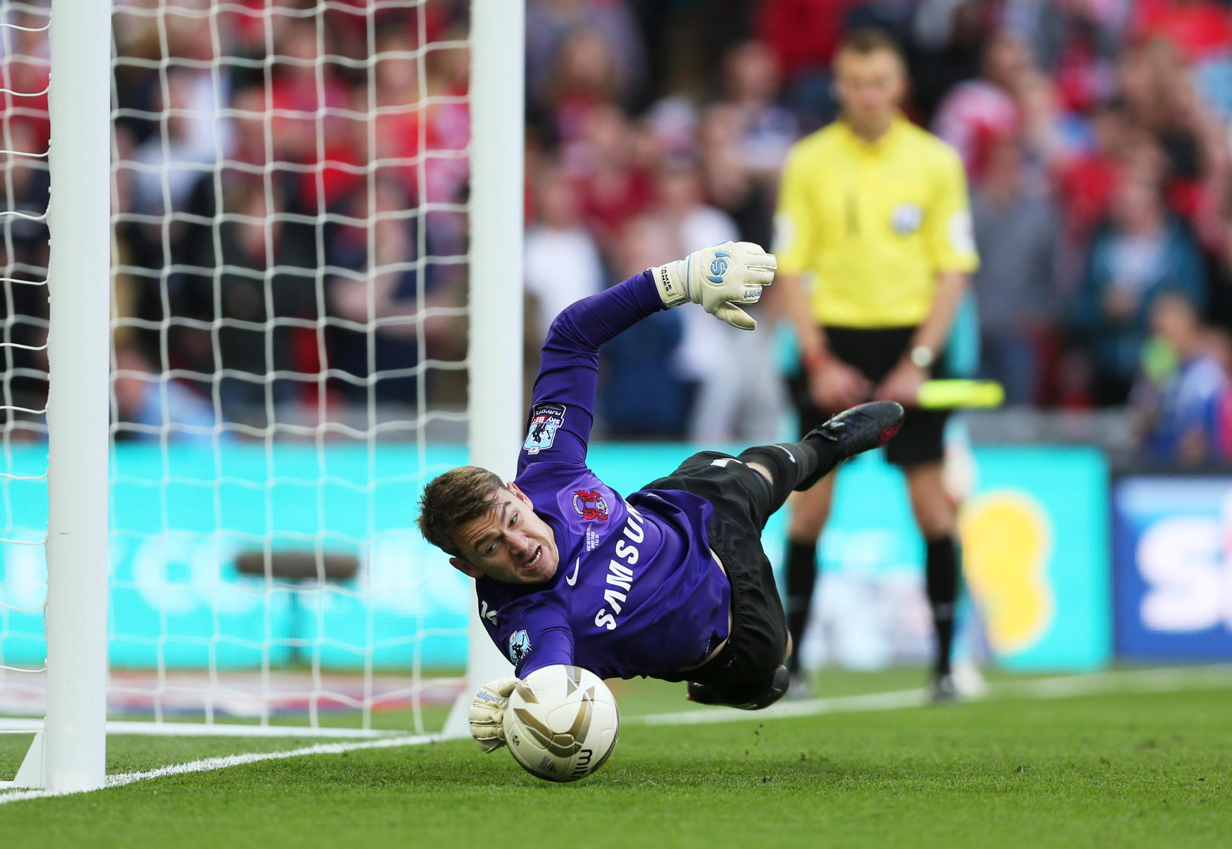 Jamie Jones saves Lee Frecklington's penalty in his final appearance for the O's. Picture: Action Images