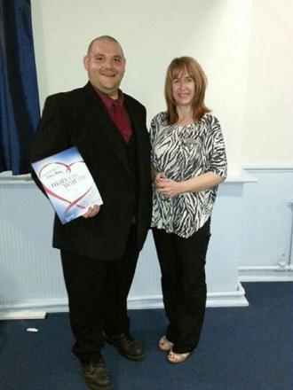 Chris Penny accepting the award from his Slimming World consultant Chris Elliott.