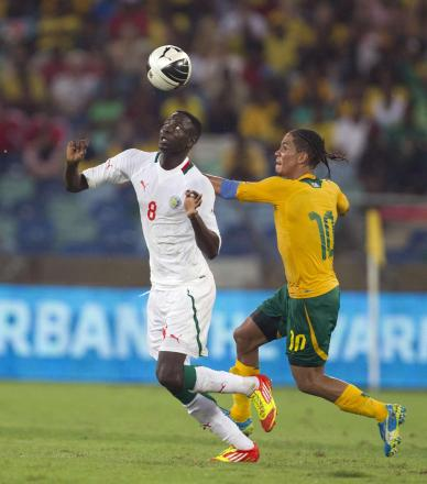 Cheikhou Kouyate (left) battles with Everton's Steven Pienaar of Australia whilst on international duty with Senegal. Picture: Action Images
