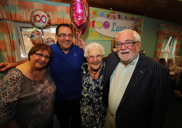 Laura Hayward celebrates her 100th birthday pictured with her son Eric Hayward (right), and friends Ljiljana (left) and Deyan Hayward (next to her)