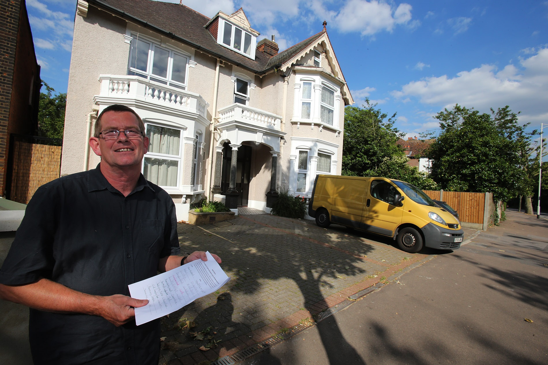 Tim Potter with the petition outside the prospective new bed and breakfast in Aldersbrook Road.