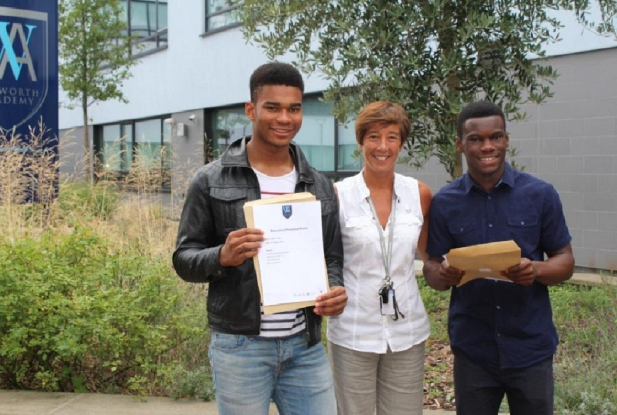 Yvonne Powell with two Walworth Academy pupils after A-Level results in August last year.