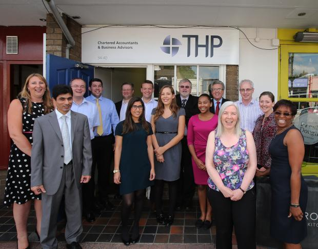 Staff at The Hart Partnership outside the Wanstead office.