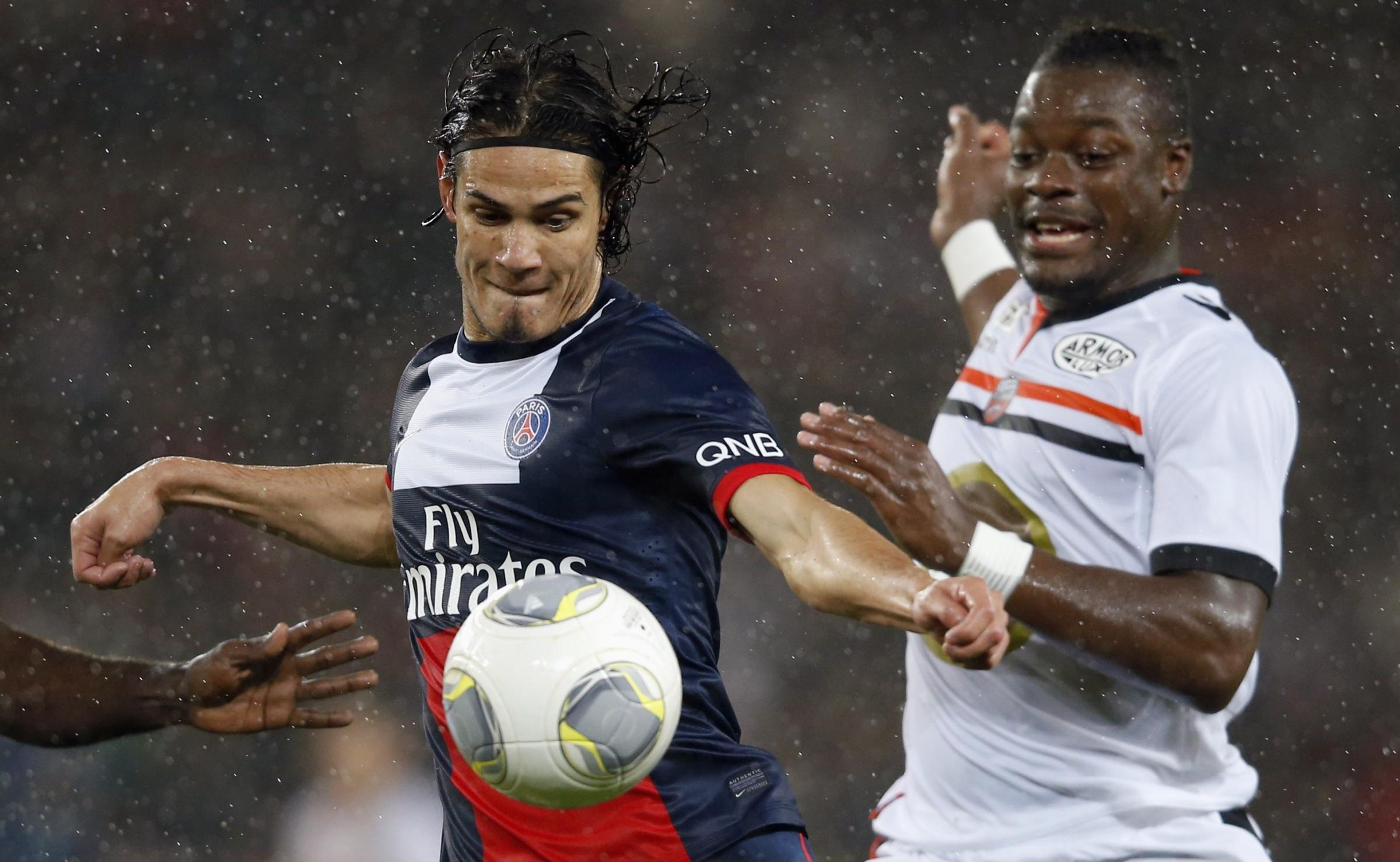 Lamine Kone (right) battles with PSG's Edinson Cavani (left). Picture: Action Images