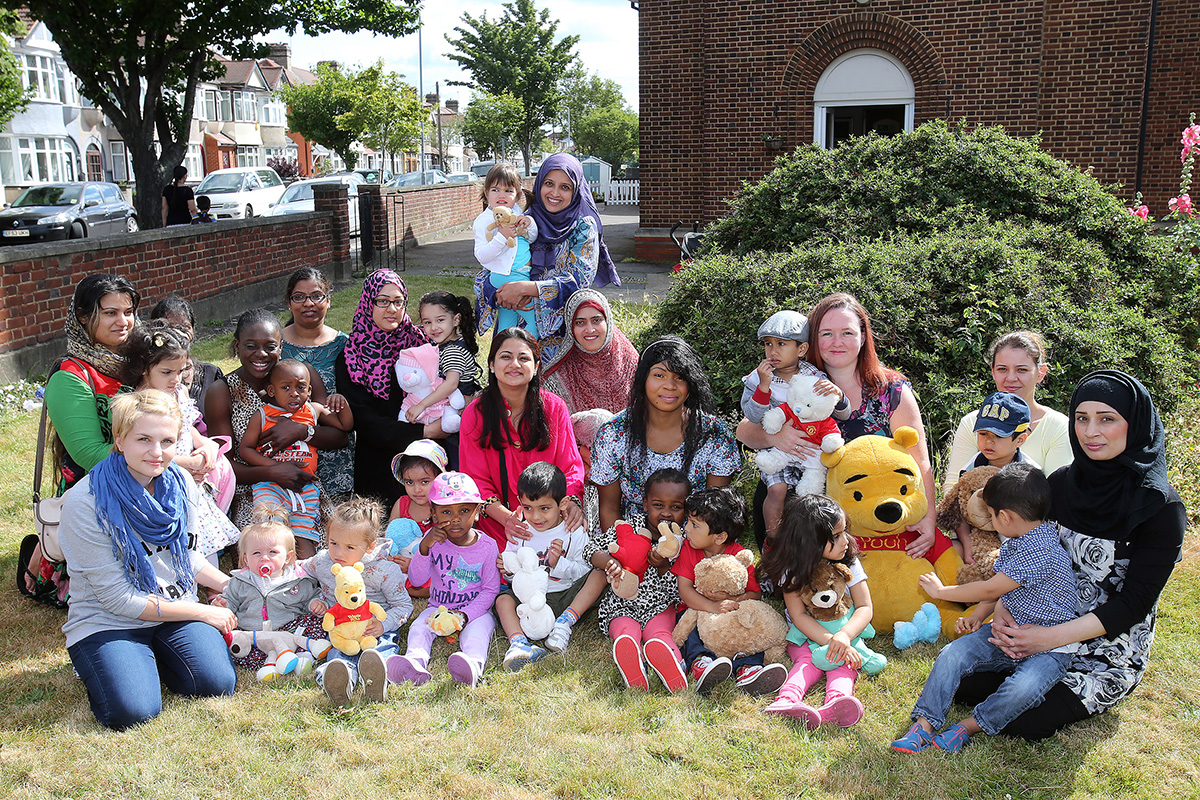 Rizwana Yasin (standing) with staff, children and parents at Be Babies Kindergarten.