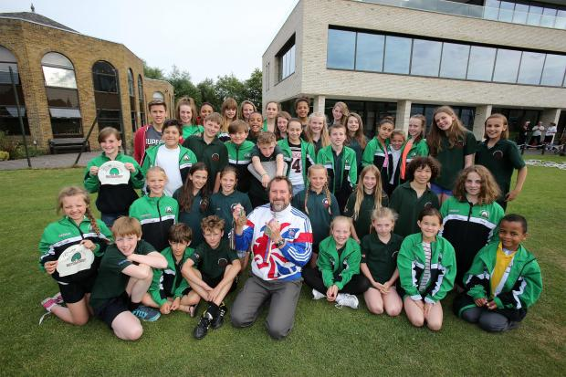 Nick Gillingham with swimmers outside Forest School's leisure centre