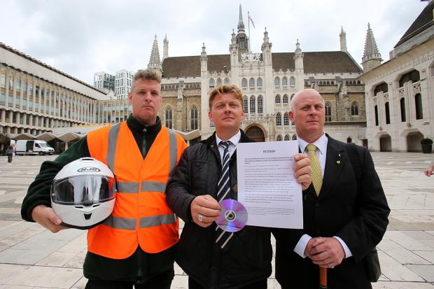 Tea hut campaigners Steve Barron, Paul Morris and Ralph Ankers deliver the petition to the Corporation of Londo