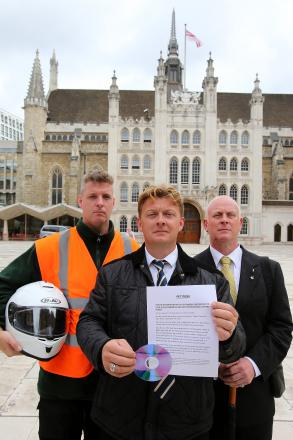 Tea hut campaigners Steve Barron, Paul Morris and Ralph Ankers deliver the petition to the Corporation of London at the Guildhall this morning