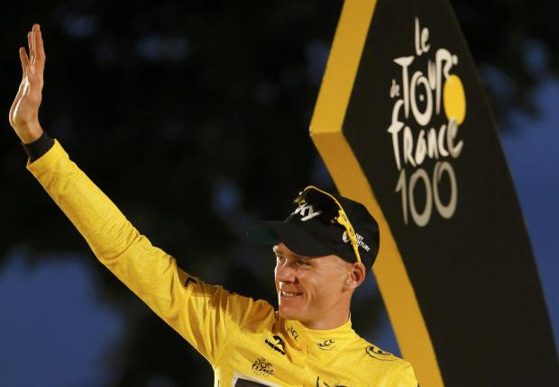 East London and West Essex Guardian Series: Chris Froome celebrating his Tour de France triumph last year. Picture: Action Images