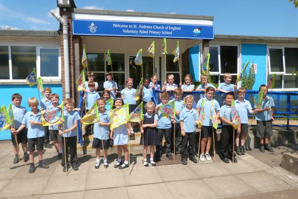 St Andrews Primary School pupils with their flags