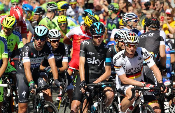 Mark Cavendish, left, at the 'Grand Depart' with defending champion Chris Froome, centre, and fellow sprinter Andre Greipel. Picture: Action Images