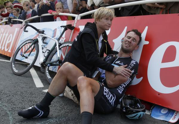 Mark Cavendish receives helps following his crash yesterday. Picture: Action Images