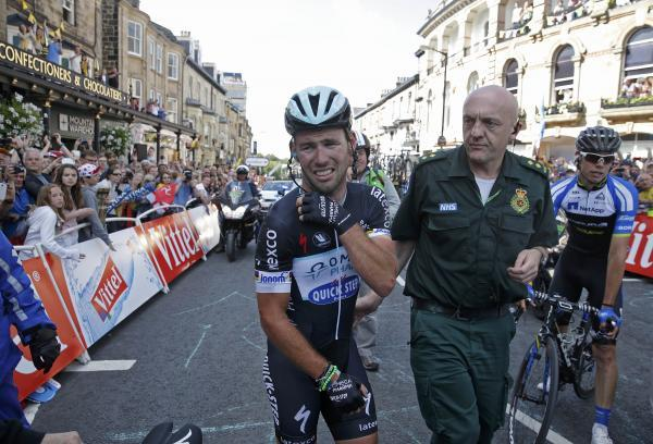 Mark Cavendish is helped by a medic following his crash yesterday. Picture: Action Images