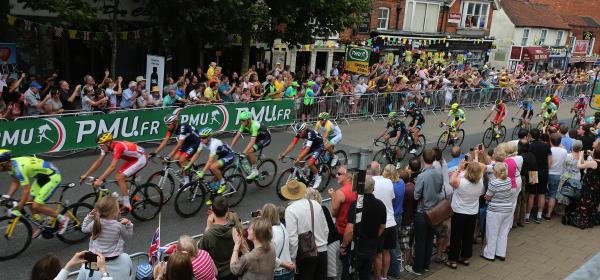 Tour de France riders come through Epping High Street