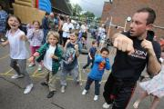 Instructor Richard Baskin of Mixed Martial Arts academy teaching children self-defence