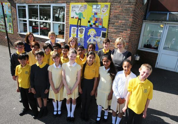 Year 6 pupils at Wells Primary School and Denise Johnson, deputy headteacher, Jackie Blount, chair of goveners and Jill Henderson, headteacher