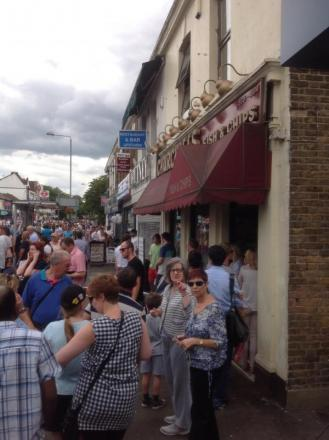 The queues outside Churchill's Fish and Chips in High Street, Woodford Green