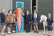 Chigwell School Art+ students with Chigwell Riding Trust manager Deborah Hall, right