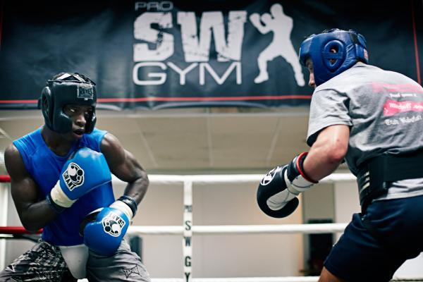 Richard Commey (left) spars with Mitchell Smith (right).
