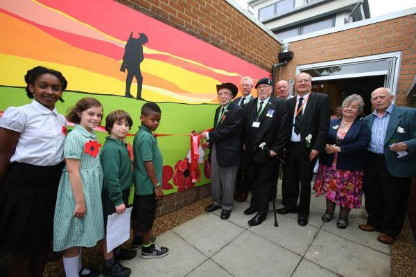 Students join with councillors and WW2 veterans for the unveiling of the mural.