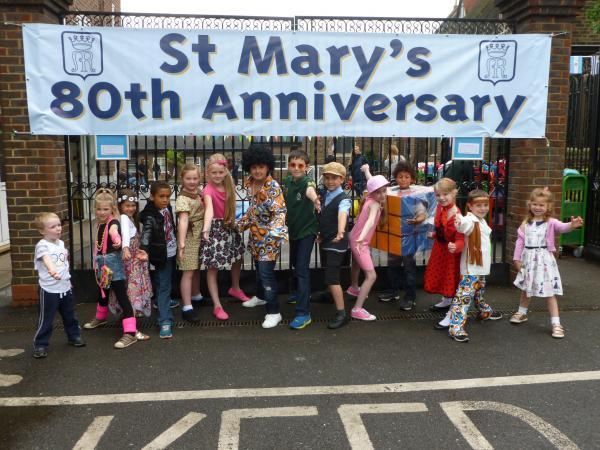 Year 4 pupils dress up in clothes from all different eras post 1930
