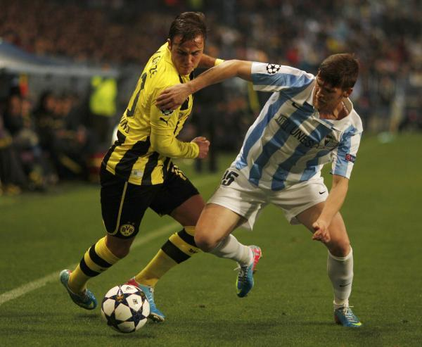 Vitorino Antunes (right) battles with Borussia Dortmund's Mario Gotze in the 2012/13 Champions League. Picture: Action Images