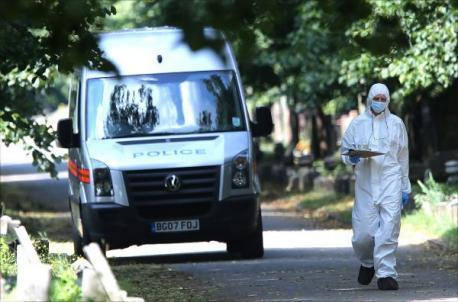 Forensics scour the scene at City of London Cemetery