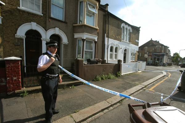 Police at the crime scene in Walthamstow yesterday afternoon