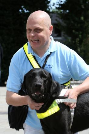 Stephen Steppen with his black Labrador Owen