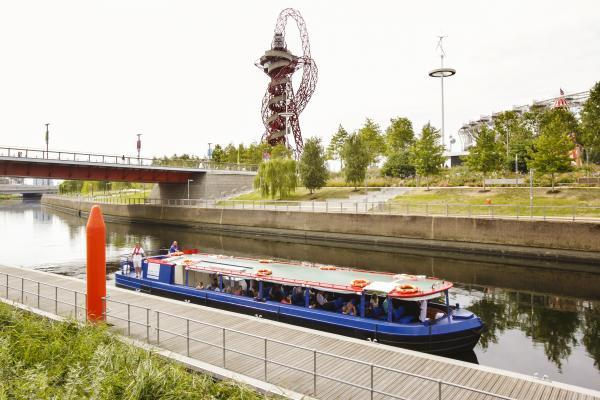 Visitors enjoying a boat tour as they pass the Orbit (Credit: LLDC)