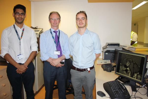 Two trainee doctors with Mr Jonathan Pollock, Clinical Director for Neurosciences