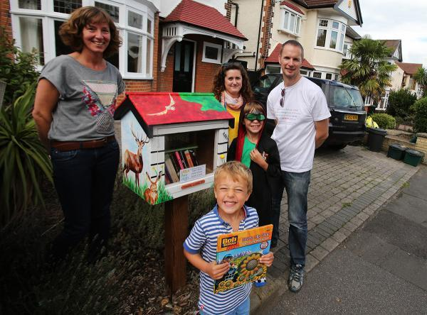 First little free library in Wanstead: Fiona Tatham and children Oliver and Freddie with artist Gabriela Castellanos and Nick Cheshire, director of Little Free Library Project UK
