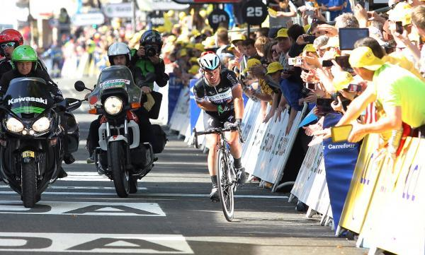 Mark Cavendish rolls over the finishing line in Harrogate following his Tour de France crash. Picture: Action Images