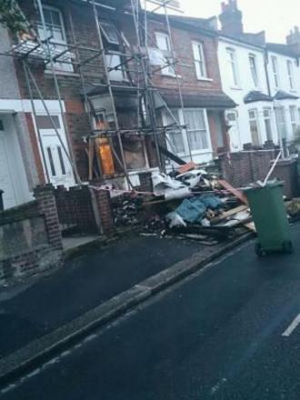 The blaze started when building waste left in the front garden caught fire and spread to the guttering.