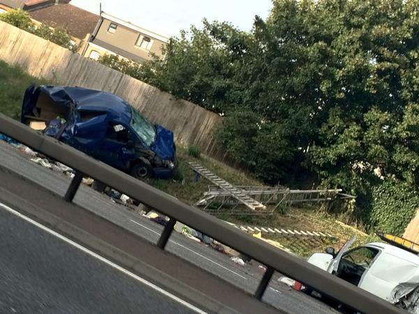 The wrecked vehicles on the side of the North Circular