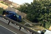 One of two wrecked cars on the side of the North Circular