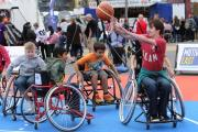 Children try out wheelchair basketball